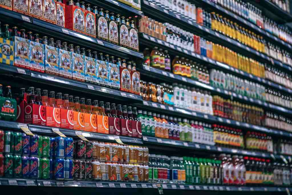 Beverages organized on a grocery store shelf
