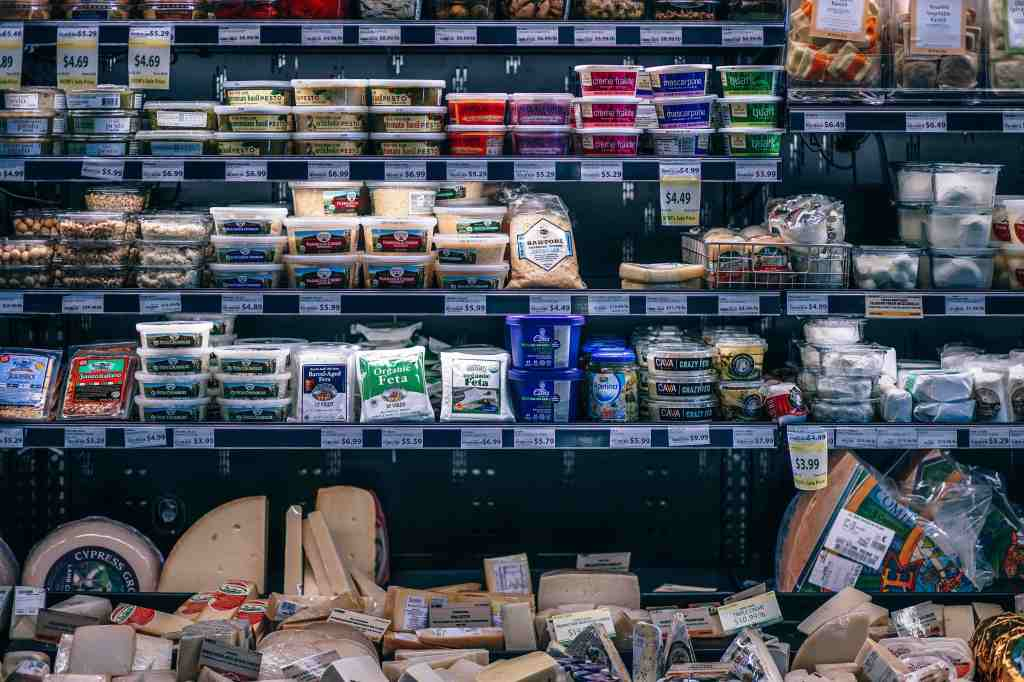 Display of cheeses at the grocery store.